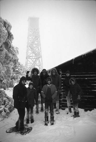 Ira Ellis, left, a founding member of Snowald, leads members of Boy Scout Troop 7 of North Haven, Conn., on a snowshoe hike in the 1970s. Snowald, a retreat founded in the 1950s on 250 acres high in the Green Mountains, continues to serve its  founders' families and scouting groups to this day.