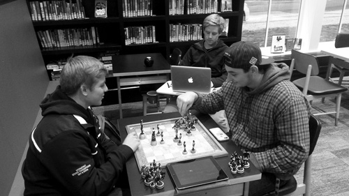 Students enjoy a game of chess at the new Manchester Community Library, which opened in November after years of planning.