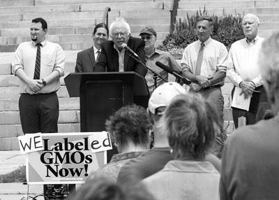 U.S. Sen. Bernie Sanders, I-Vt., joined other elected officials and activists on July 1 to celebrate the start of Vermont's new law requiring labeling of genetically modified foods. The achievement would prove short-lived, as Congress voted later in July to nullify the Vermont law and any others like it. Roger Crowley photo/courtesy Vermont Public Interest Research Group