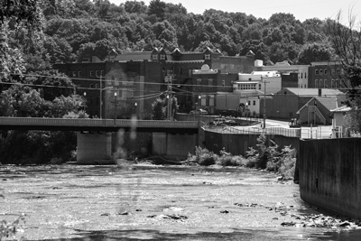 Downtown Hoosick Falls is seen from across the Hoosic River. The groundwater that supplies the village water system remains heavily contaminated, and a local manufacturing plant near the water supply was designated as a federal Superfund site last month. Joan K. Lentini photo